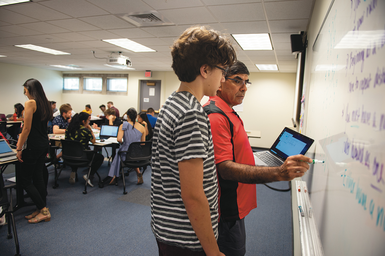 Distinguished Professor Saad El-Zanati introduces math research to Chicago high school students at his summer camp.