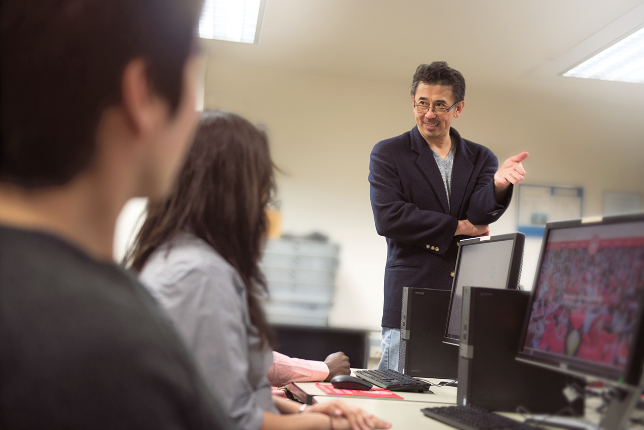 Man teaching college students in a classroom