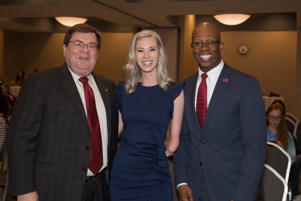Former Miss Iowa Nicole Kelly picture with President Larry Dietz and Vice President for Student Affairs Levester Johnson.