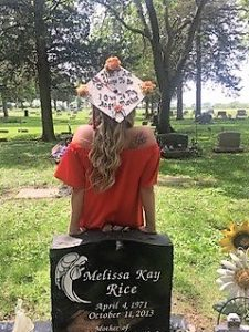 Elizabeth Rice lost her mother her freshman year. She visited her grave after earning her bachelor's degree in 2017 from Illinois State University.