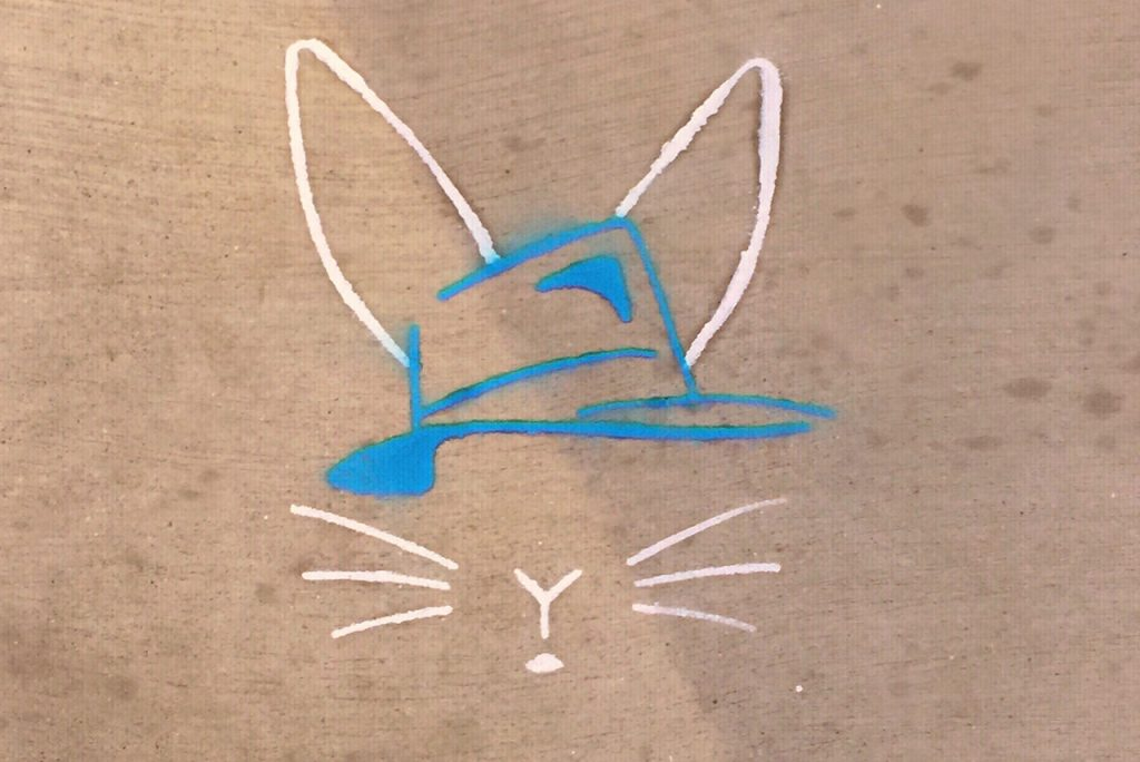 Image from the production poster of a white line-drawn rabbit, wearing a blue hat.