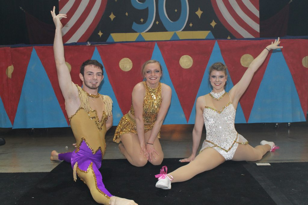 Honors students in the circus pose in costume