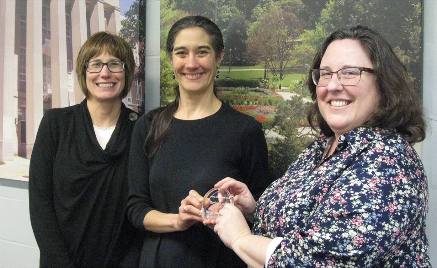 Three women during an award presentation