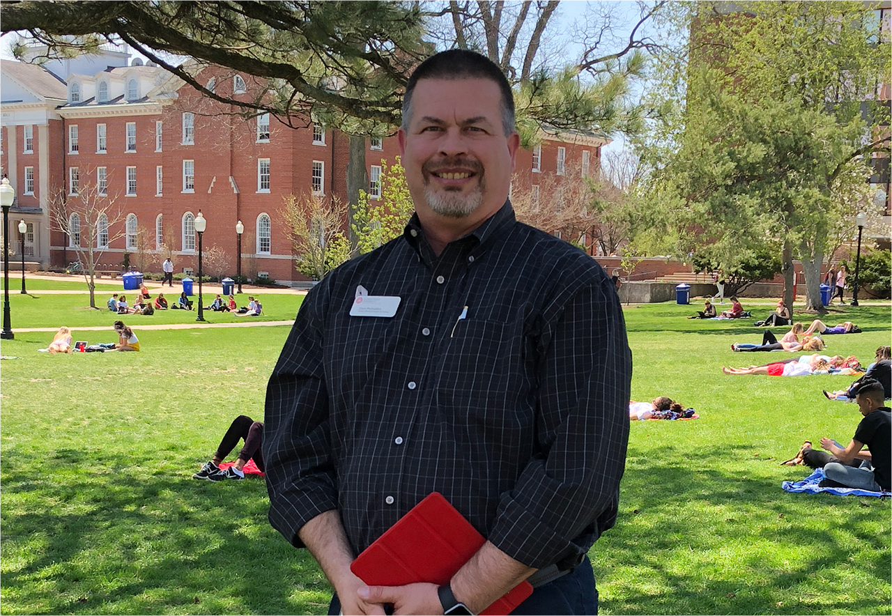 Dean Plumadore, standing on the Quad on a sunny day