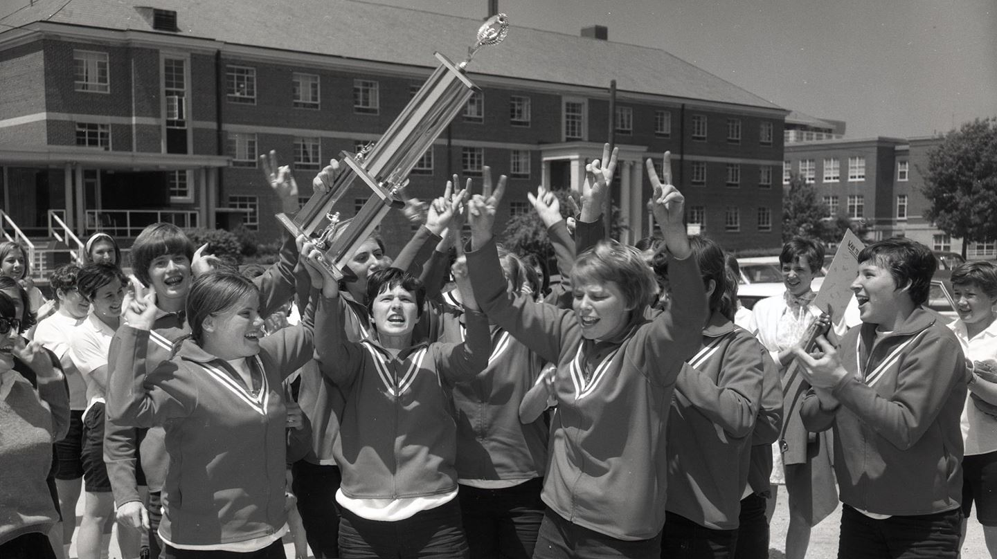 Members of the 1969 Redbird softball team celebrate their runners-up finish in the first Women's College World Series.