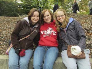 three ISU students enjoying the homecoming parade