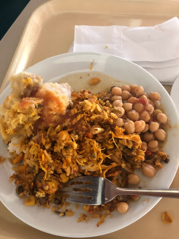 Lunch consisting of beans, rice, potatoes and chicken.