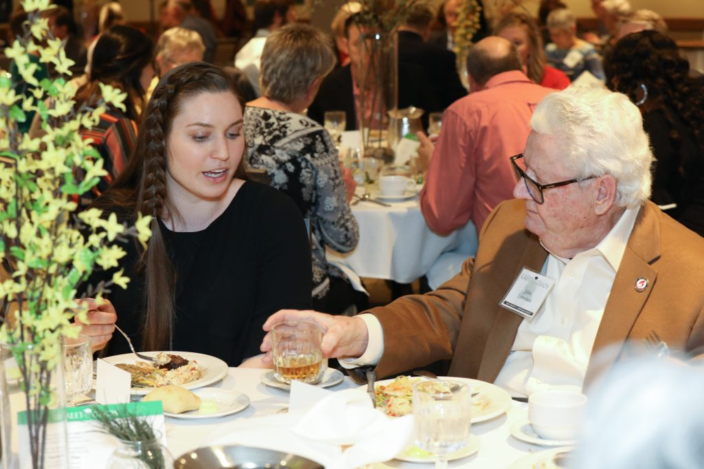 Nursing major Abby Mustread visits with donor John Lawrence at Greet our Grads.