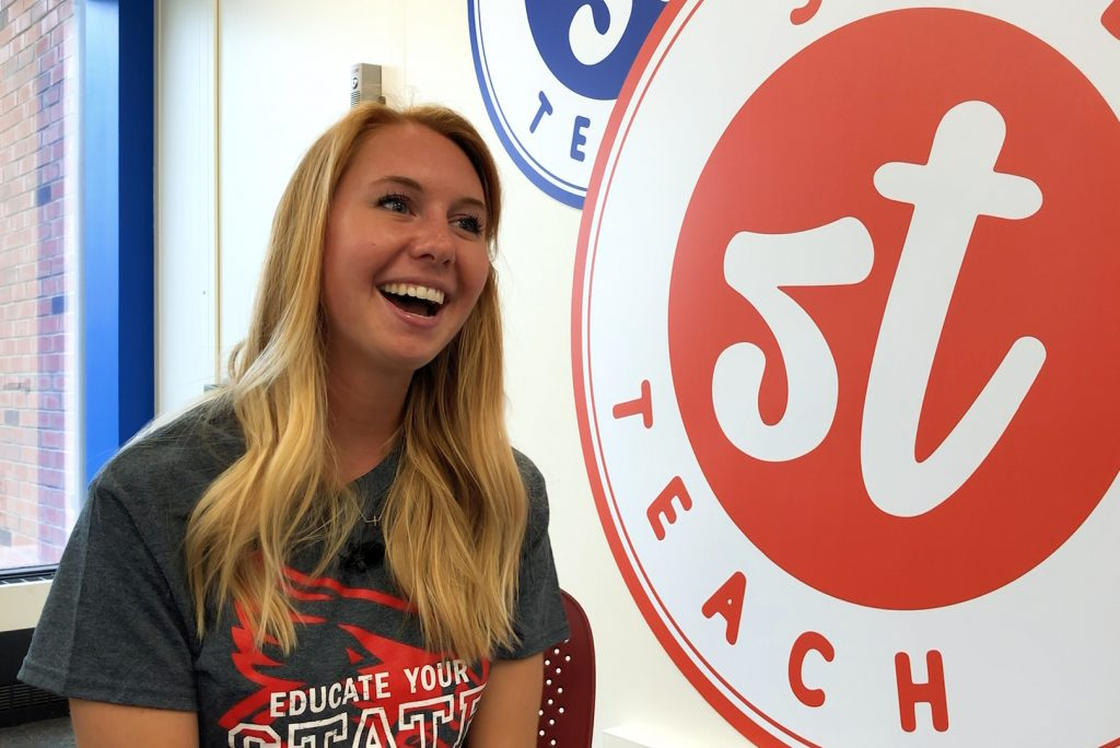 Illinois State transfer student sits and talks in Studio Teach in DeGarmo Hall