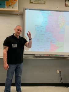Erik Rankin standing in a classroom