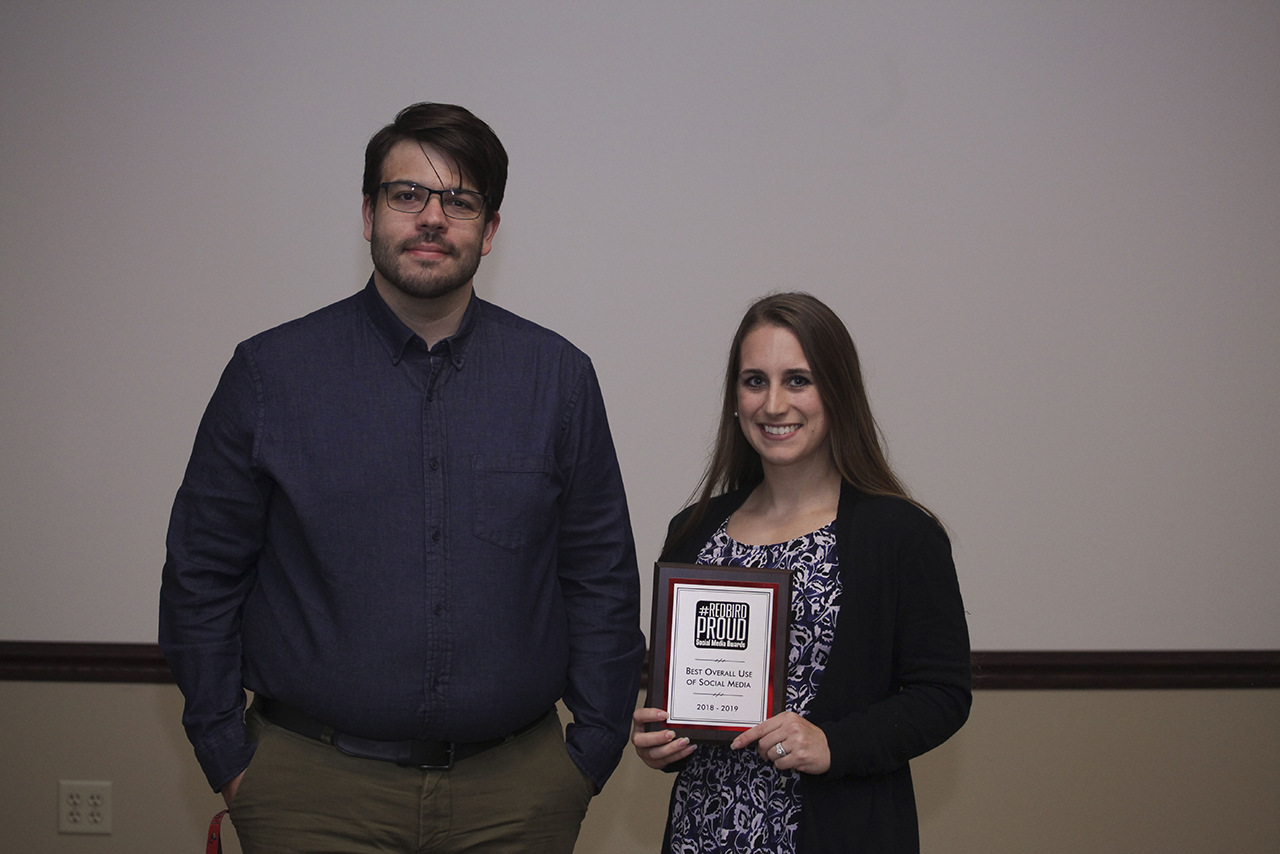 Lauren Morris, on behalf of Illinois State Cheeerleading, accepts the award for Best Overall Use of Social Media from UMC social media coordinator Tyler Emken.