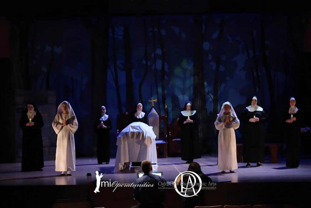 actors portraying nuns on stage