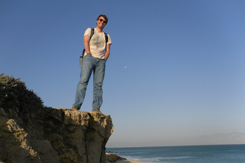 Zac Chase on the shores of Western Cape in South Africa where he led trainings for teachers on educational technologies.