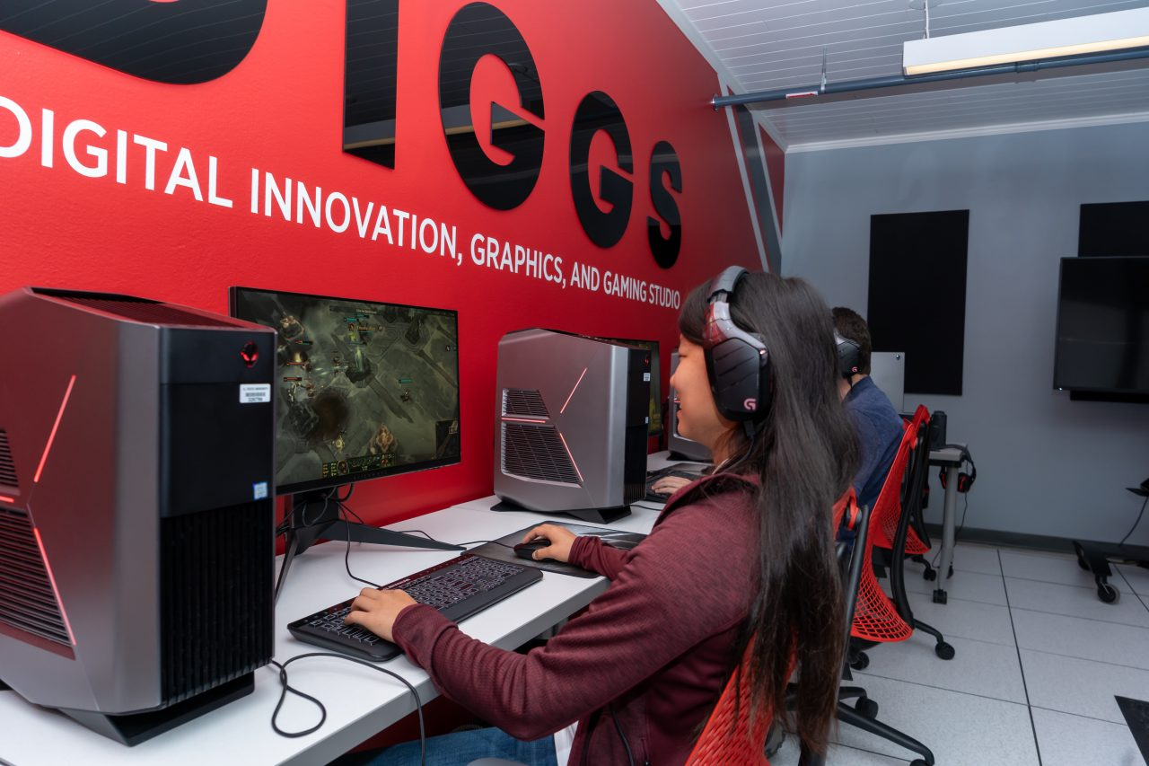 Illinois State University student playing video games.