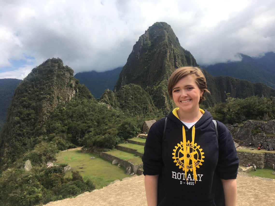 Featured student Sarah Sanders posing for a scenic shot in Peru