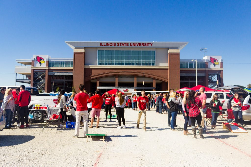 Students tailgating in the parking lot in front of Hancock Stadium