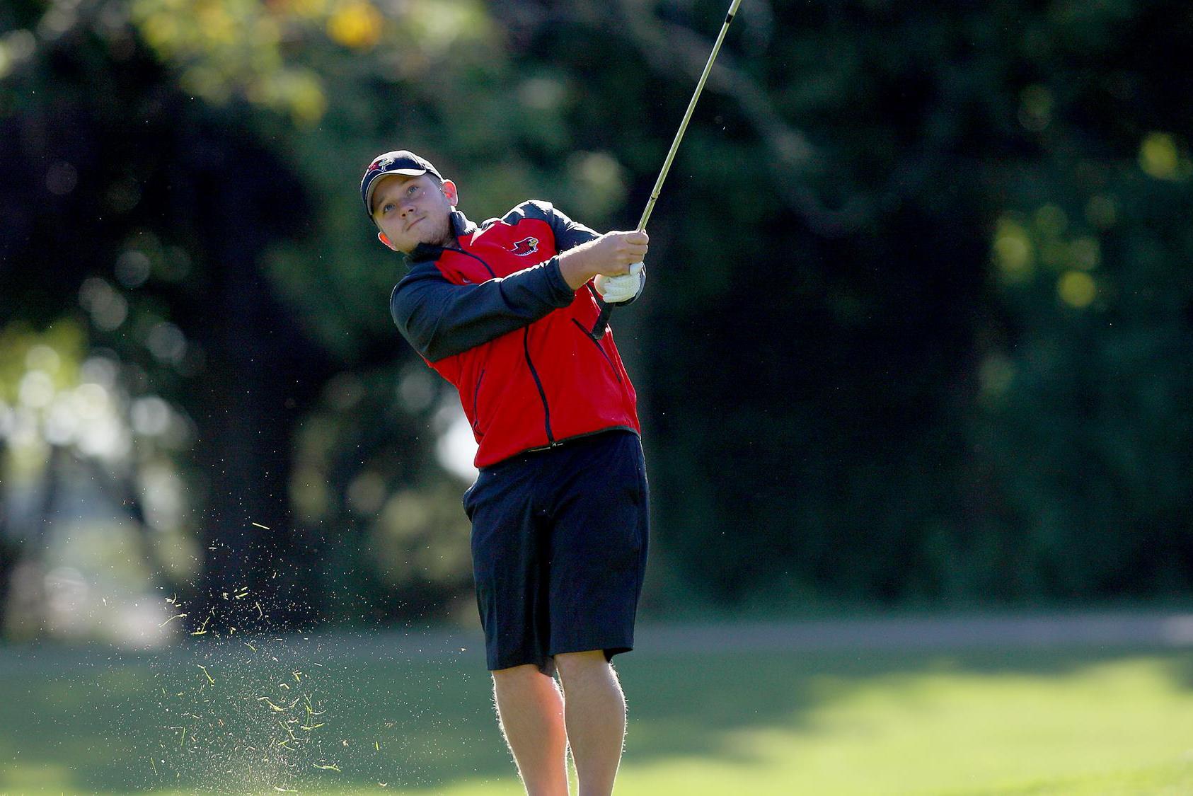 Trent Wallace swinging a golf club