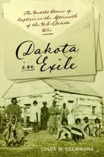 Cover of book Dakota in Exile: The Untold Stories of Captives in the Aftermath of the U.S.-Dakota War with images of an evnelope and a wooden barrack with people standing in front