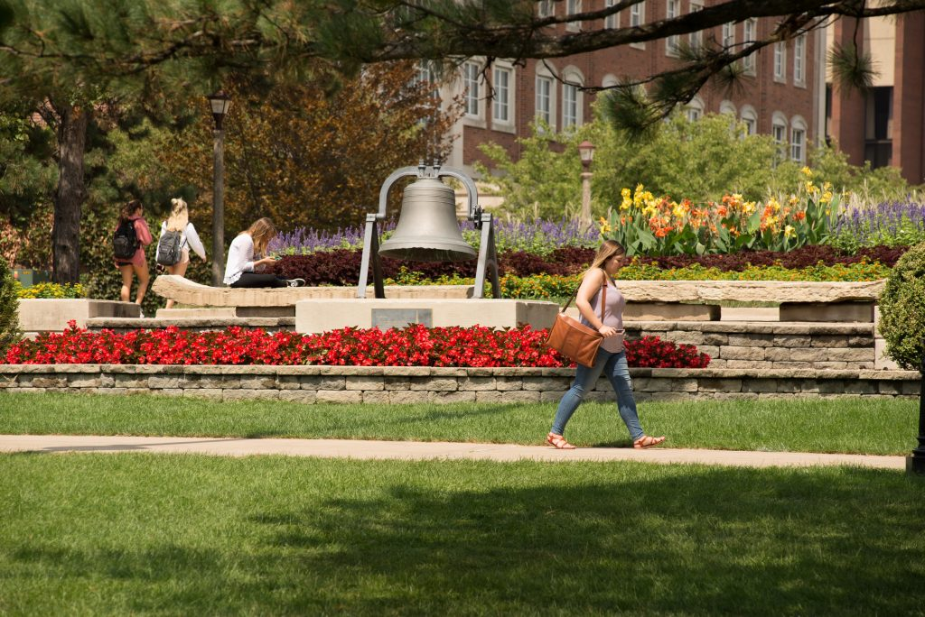student walking on quad in summer