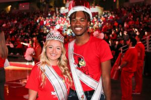 Two students in crowns and sashes
