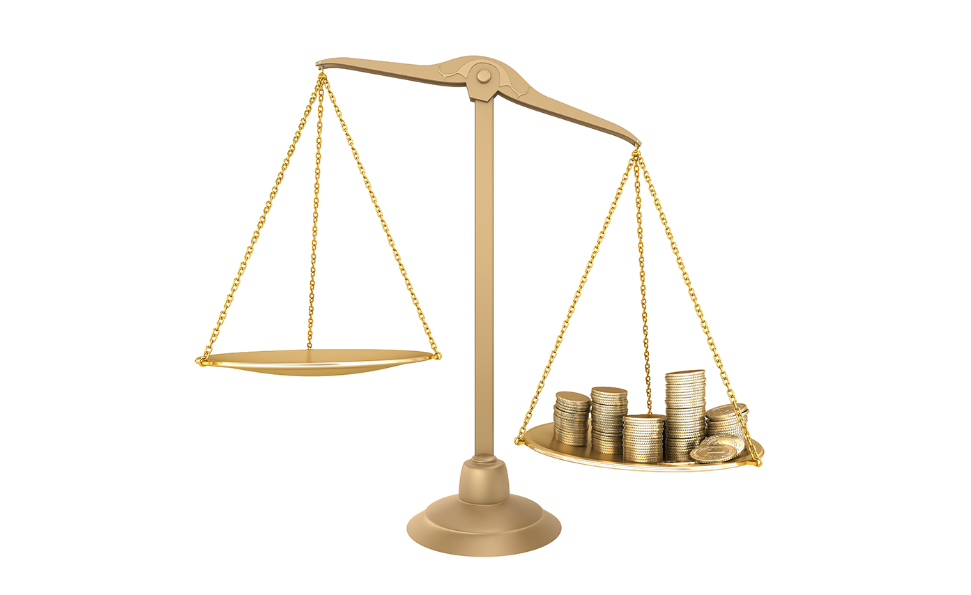 scales with gold coins tipped to one side