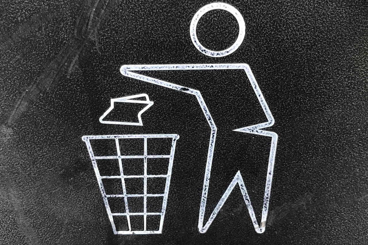 Photo by Gary Chan on Unsplash stick figure throwing away trash in a trash can