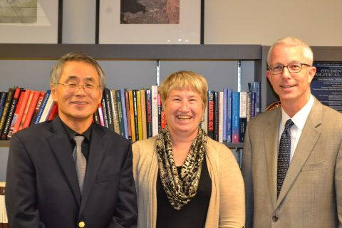 group photo of the department chair, a professor and a guest speaker