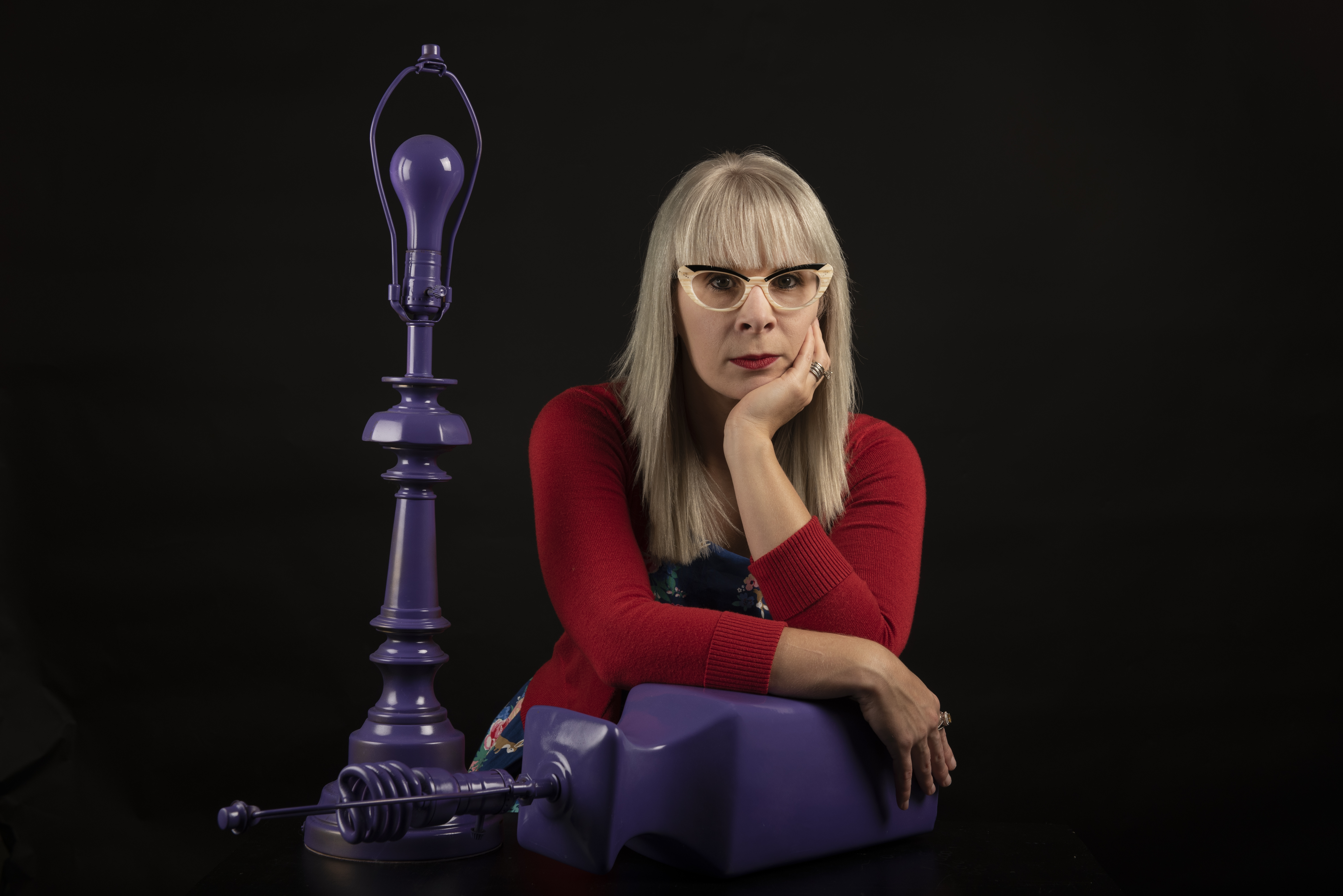 Shelly Clevenger next to a purple lamp