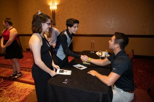 Schulyer Bailar spoke with and signed autographs for attendees following his speech at the LGBTQA Cultural Dinner.