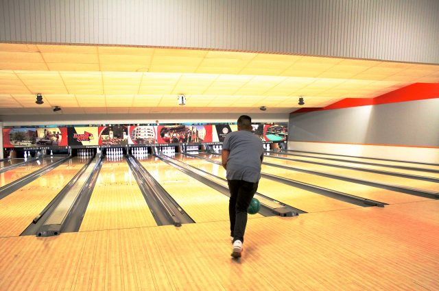 Student bowling at the Bowling and Billiards Center