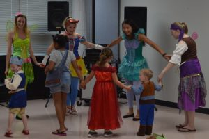 ISU students in Disney costumes dance with young children