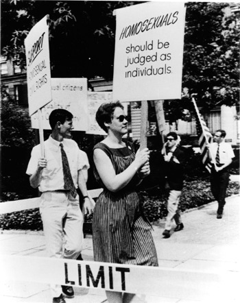 Barbara Gittings holding a protest sign that reads Homosexuals should be judged as individuals
