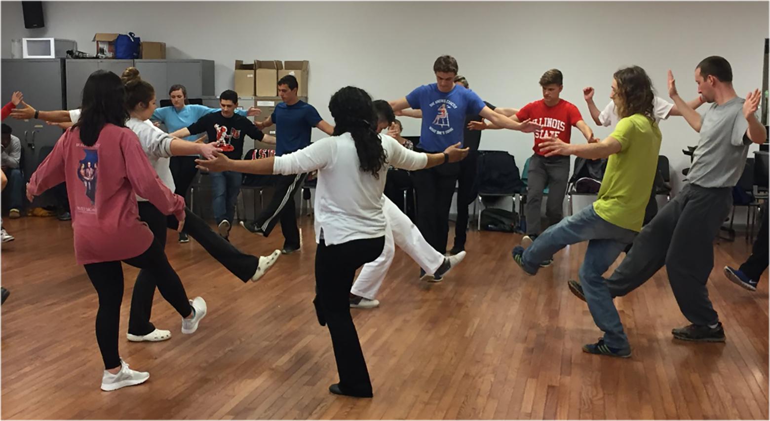 People performing Capoeira