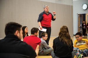 Professor teaching future PE teachers.