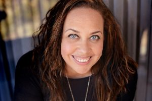 headshot of Kelly Hurst