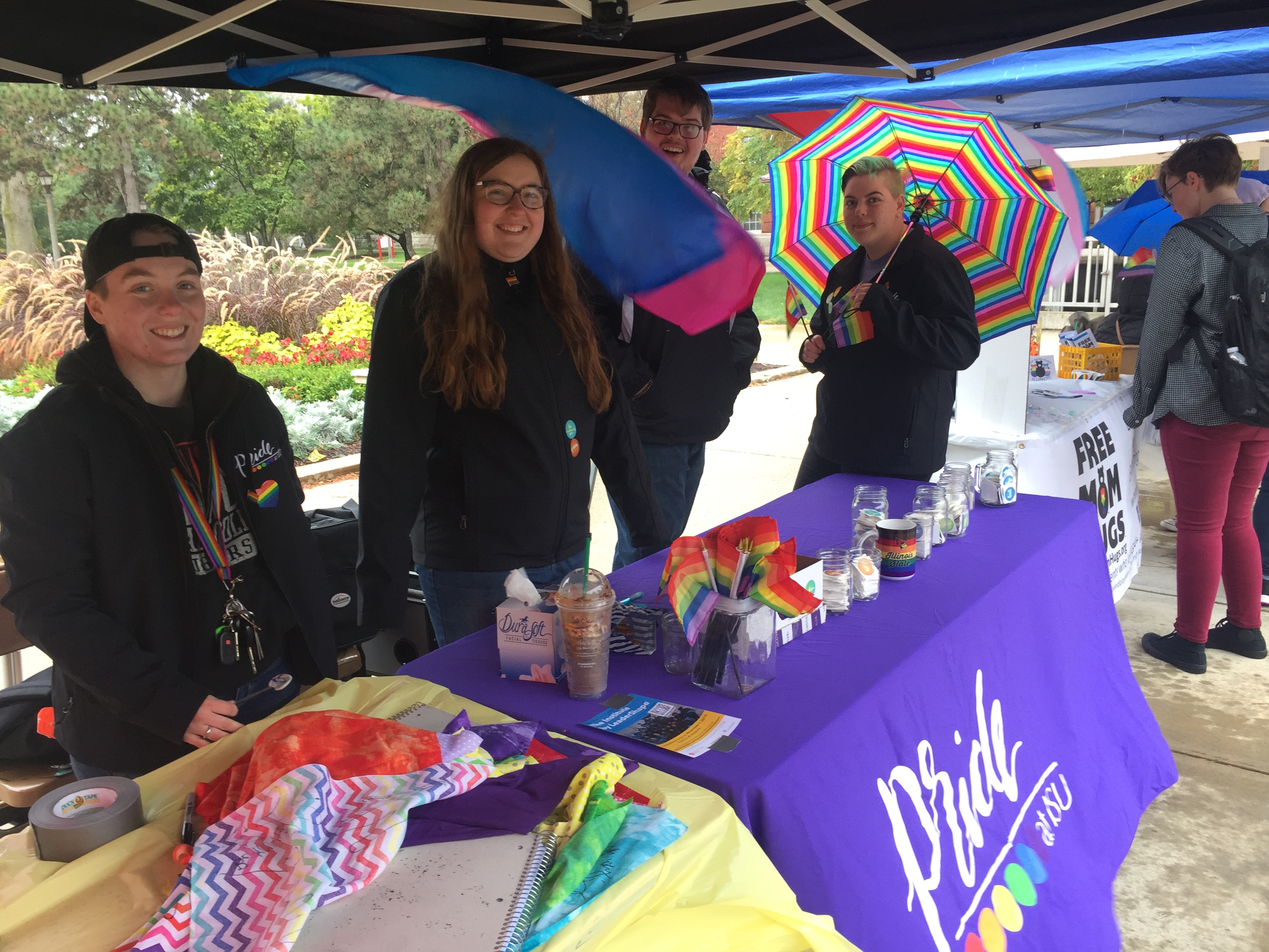 ISU Pride President Emily Patterson (second from left) and fellow Pride members tabled last Friday on the Quad to offer information and words of encouragement to students on National Coming Out Day.