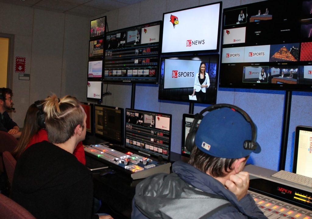 Students in TV-10 studios looking at monitors.