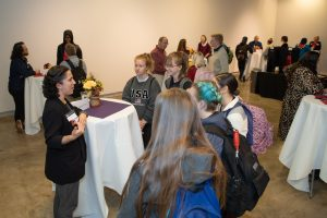 Students and alumni conversing at the second annual CreativeCon