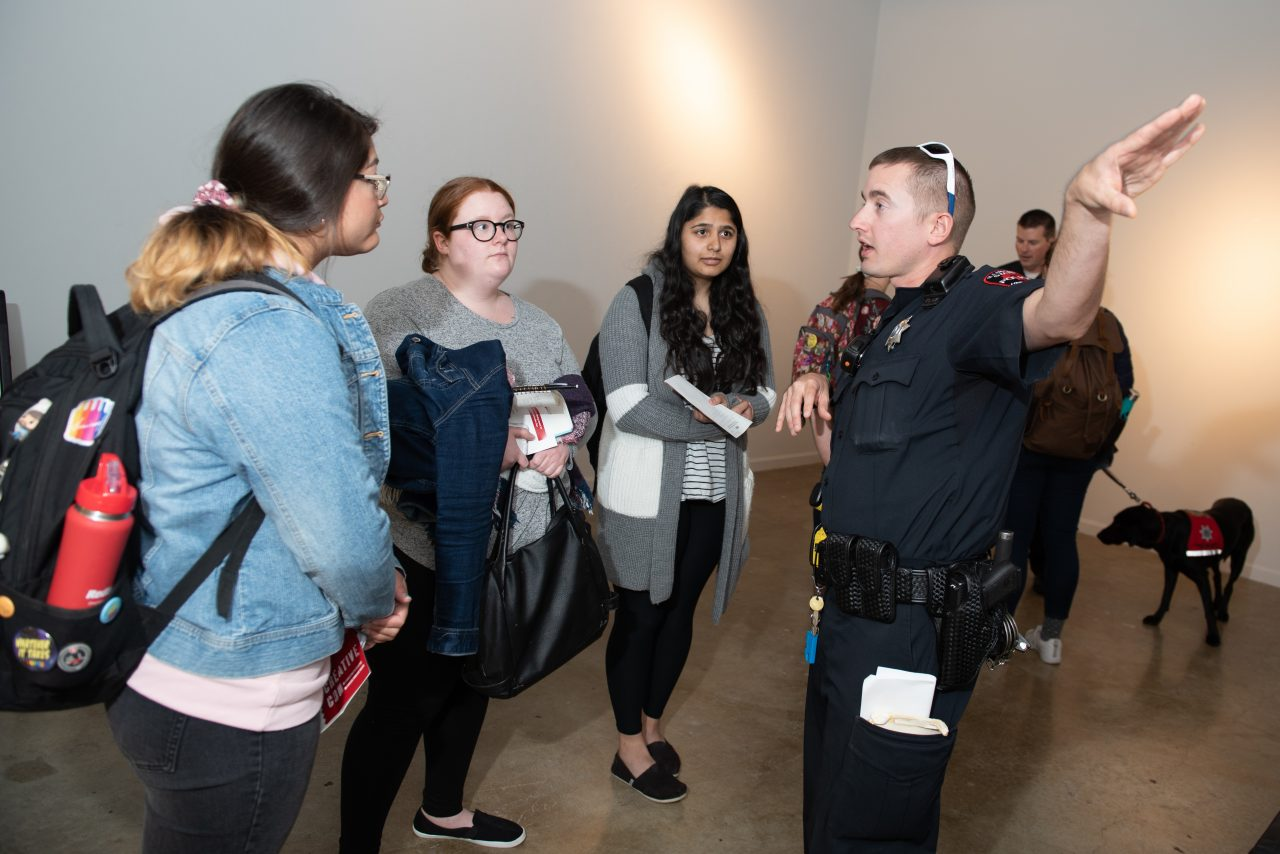 Illinois State University Police Department talking to students at CreativeCon