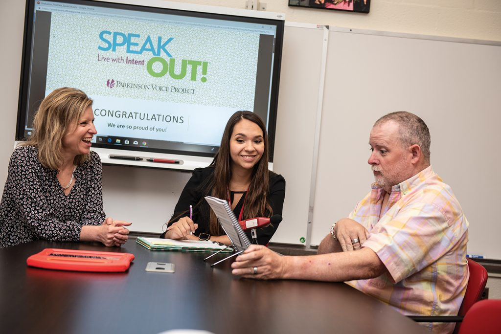 An educator and a graduate student working with a client during a speech therapy session.