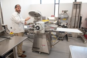 ISU chef with baking equipment.