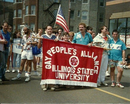 People marching with a banner that says Gay People's Alliance Illinois State University