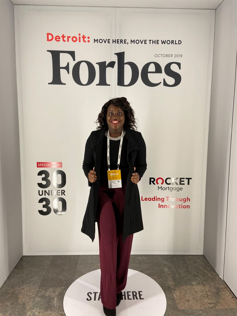 Ngozi Ukweni standing in front of a Forbes backdrop