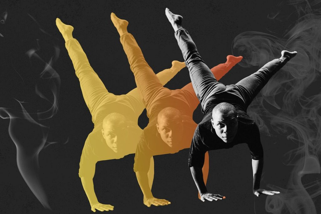 Image of dancer in a handstand like pose with smoke graphic following his orange and yellow shadows..