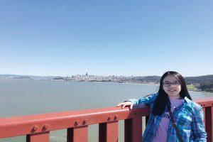 Girl standing next to bridge