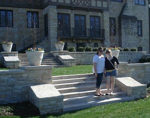 two girls standing in front of Ewing Manor