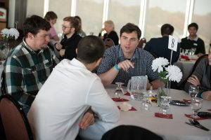 Student talking to other attendees at an event