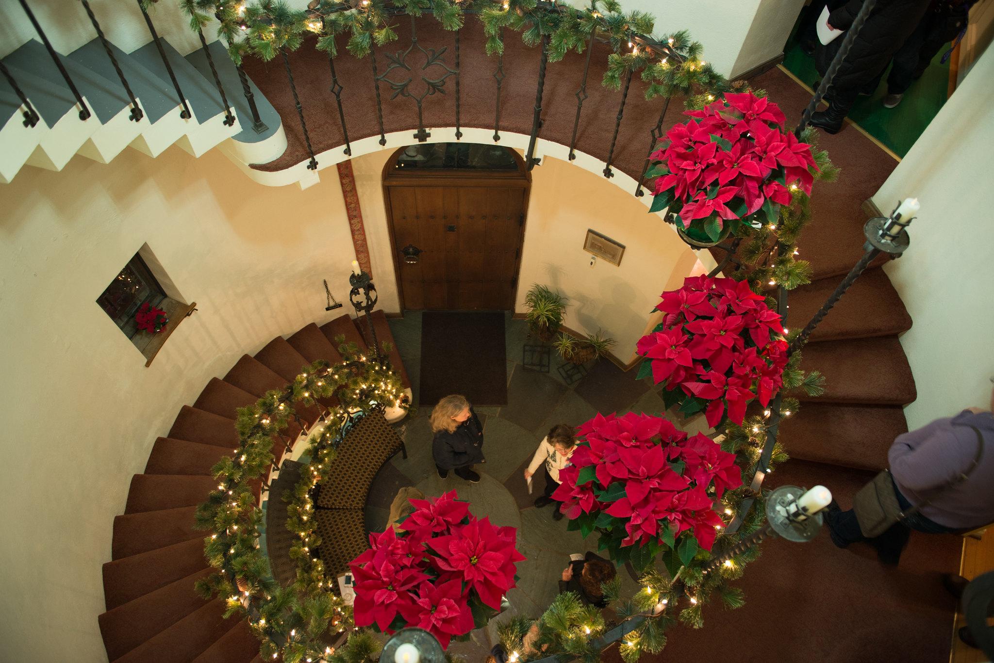 poinsettias don the spiral staircase