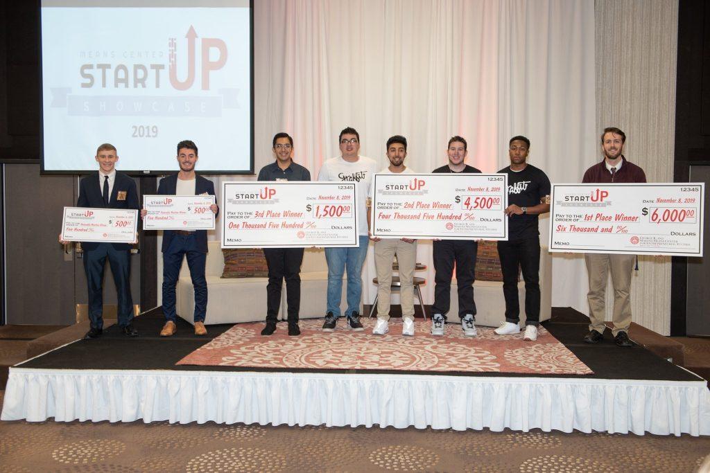 Startup Showcase winners with checks.