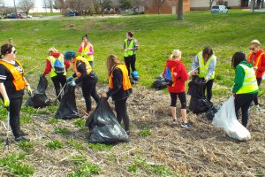 Students cleaning up an area